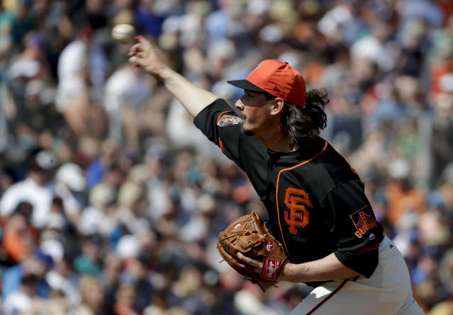 San Francisco Giants starting pitcher Jeff Samardzija throws against the Seattle Mariners during the third inning of a spring baseball game in Scottsdale, Ariz., Friday, March 9, 2018. (AP Photo/Chris Carlson)