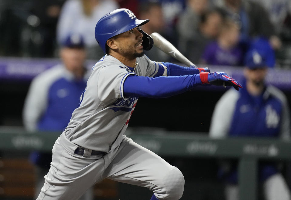 Los Angeles Dodgers' Mookie Betts follows the flight of his RBI-single off Colorado Rockies starting pitcher Antonio Senzatela in the fifth inning of a baseball game Tuesday, Sept. 21, 2021, in Denver. (AP Photo/David Zalubowski)