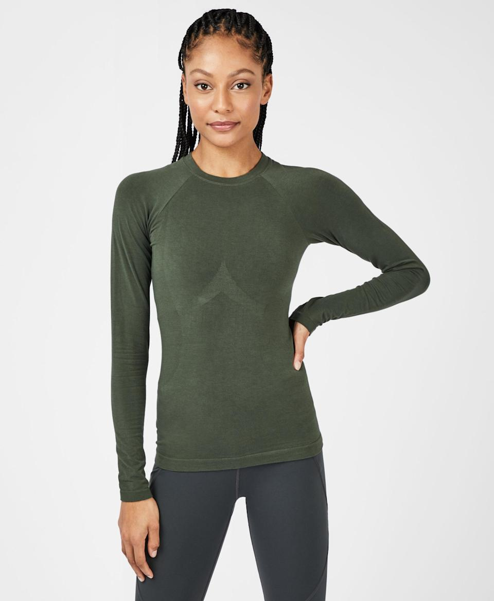 """<h3>Sweaty Betty Glisten Bamboo Long Sleeve Workout Top</h3> <br>If you prefer light, long-sleeved tops when hiking, this eco-friendly bamboo-knit one is <em>it</em>. (Pro tip: It also has antibacterial properties that help counteract B.O., because if you're hiking outside, you're bound to work up a sweat.)<br><br><strong>Sweaty Betty</strong> Glisten Bamboo Long Sleeve Workout Top, $, available at <a href=""""https://go.skimresources.com/?id=30283X879131&url=https%3A%2F%2Fwww.sweatybetty.com%2Fus%2Fshop%2Ftops%2Flong-sleeve-tops%2Fglisten-bamboo-long-sleeve-workout-top-SB063A_BeetleBlueA.html%3Fcgid%3Dlong-sleeve-tops%26dwvar_SB063A__BeetleBlueA_color%3Dbeetlebluea%26tile%3D6"""" rel=""""nofollow noopener"""" target=""""_blank"""" data-ylk=""""slk:Sweaty Betty"""" class=""""link rapid-noclick-resp"""">Sweaty Betty</a><br>"""