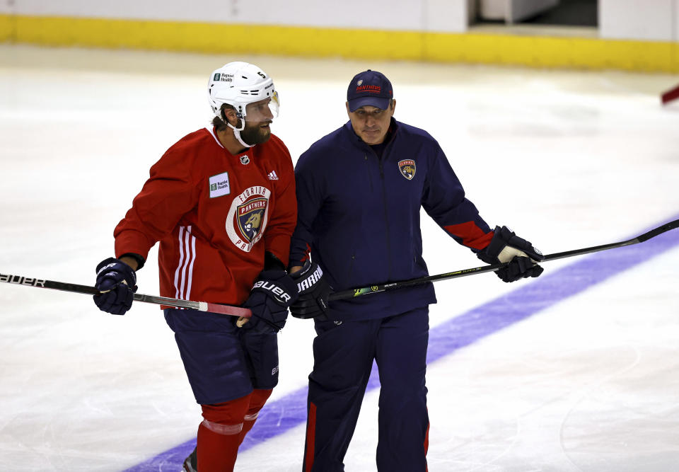 Florida Panthers assistant coach Andrew Brunette, right, skates with defenseman Aaron Ekblad (5) during an NHL hockey training camp Thursday, Sept. 23, 2021, in Sunrise, Fla. (David Santiago/Miami Herald via AP)