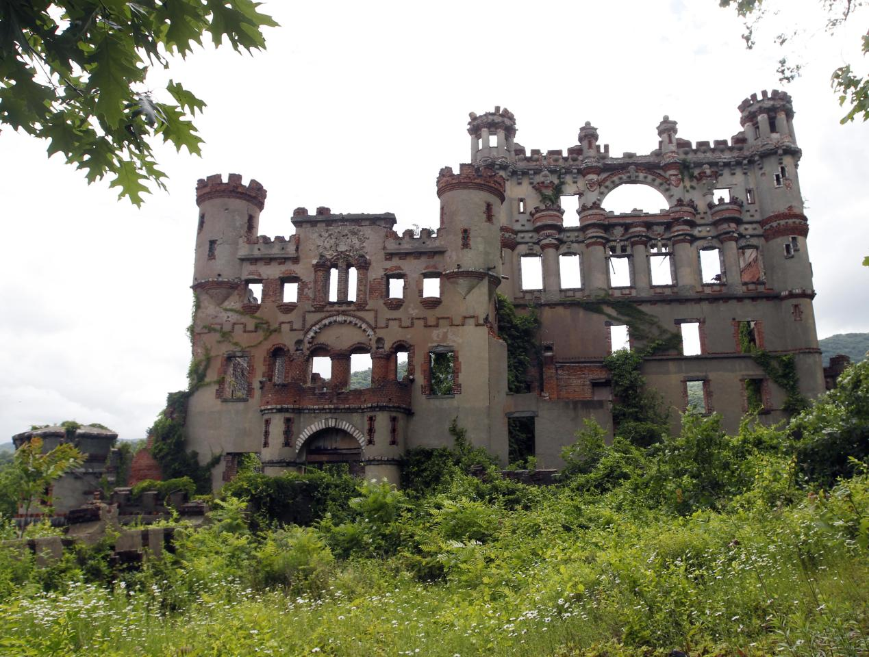 The Bannerman's Island Arsenal is seen on Pollepel Island, N.Y., on Tuesday, June 5, 2012. Though it looks like it was built to withstand battering rams, it was actually a surplus military goods warehouse made to resemble a Scottish castle. Businessman Francis Bannerman VI had it built early in the 20th century as a place to store helmets, haversacks, mess kits and munitions he could not store in his thriving shop in Manhattan. (AP Photo/Mike Groll)