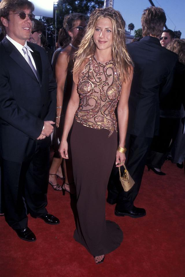 <p>As the star of a hit show, Aniston upped the ante at the Emmys in a grown with a sequin embroidered bodice. </p>