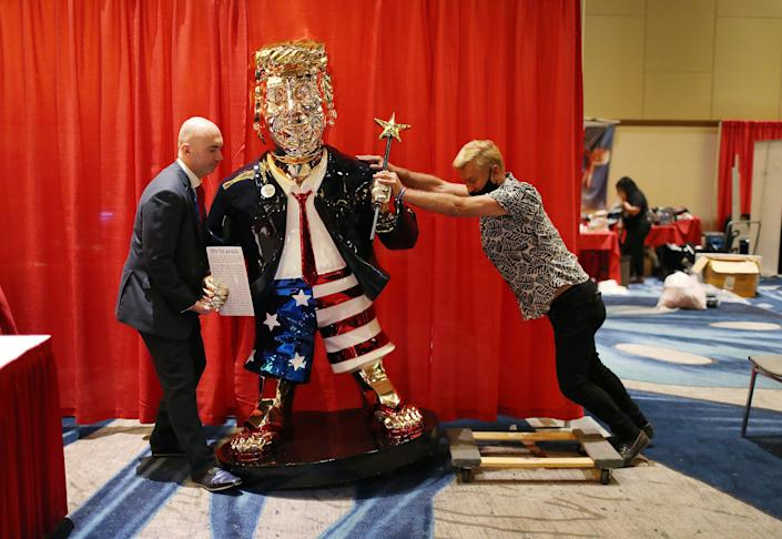 Republicans roll out a golden statue of Donald Trump ahead of his speech to the Conservative Political Action Convention, one month before the insurrection. (Photo: Joe Raedle via Getty Images)