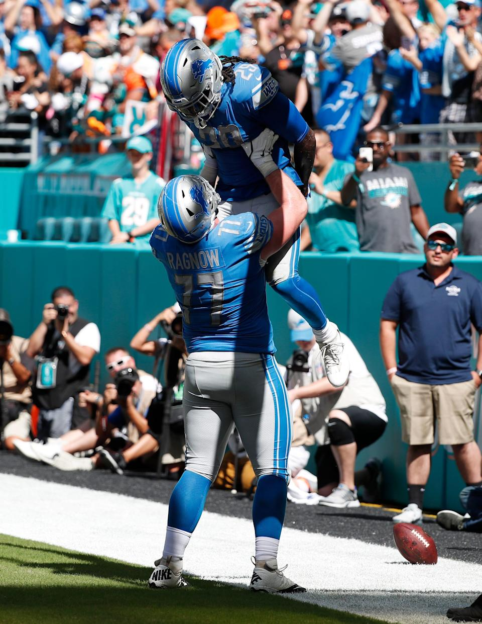 Lions offensive guard Frank Ragnow lifts running back LeGarrette Blount after Blount scored a touchdown, during the first half of the Lions' 32-21 win on Sunday, Oct. 21, 2018, in Miami Gardens, Fla.