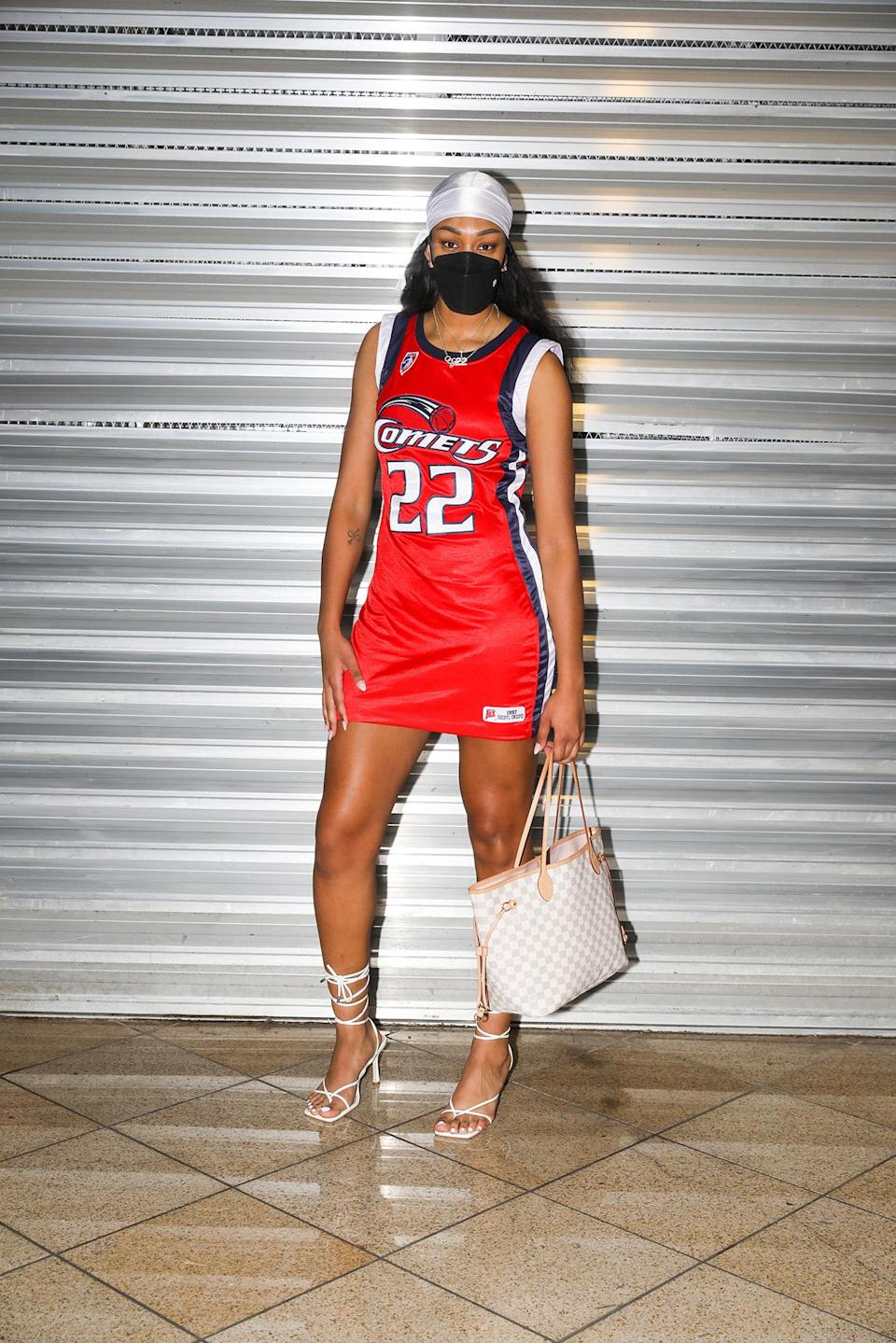 Las Vegas Aces star A'ja Wilson in a custom jersey dress of Sheryl Swoopes' Houston Comets jersey. - Credit: Kyle Lumague