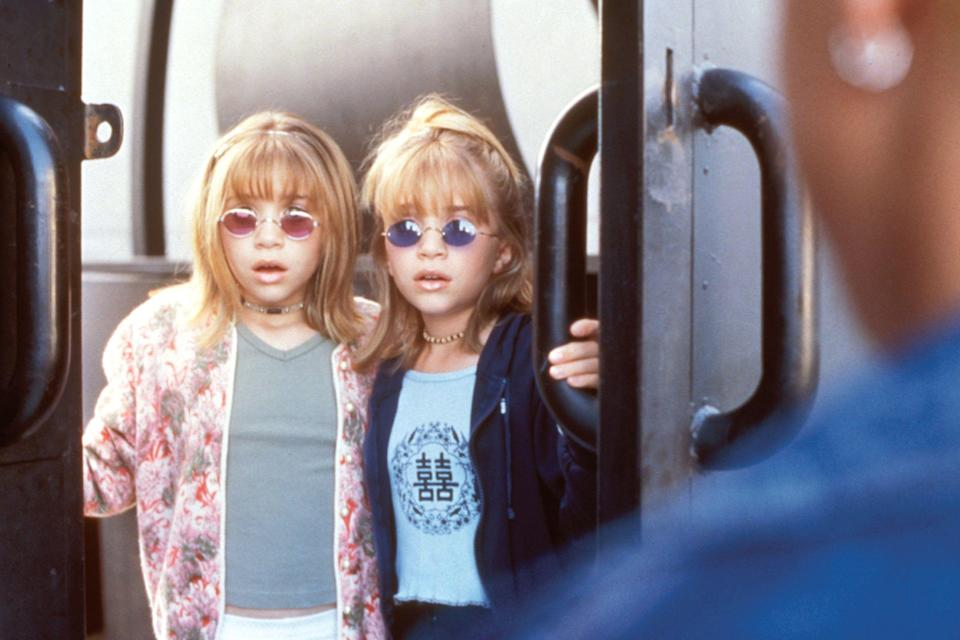 """<p><strong>How did you first cross paths with the Olsens?</strong><br>""""I was hired to style them when they were nine-years-old, for one of their straight-to-video movies. I got the job through a director I'd just worked for; I met them after <em>Full House</em> was over. I came in with two racks, and met the girls and their nanny/handler at the time, <a href=""""http://www.nytimes.com/2001/05/27/magazine/the-olsen-juggernaut.html"""" rel=""""nofollow noopener"""" target=""""_blank"""" data-ylk=""""slk:Jill Zimmerman [now EVP of Dualstar Entertainment]"""" class=""""link rapid-noclick-resp"""">Jill Zimmerman [now EVP of Dualstar Entertainment]</a> — and we all fell in love. They loved what I did, and [the director] said I was the first person who really got the girls and who they were. I was hired to style them for everything they were doing. I had such a hard time finding clothes for them, because there wasn't anything out there that I really wanted to put them in. I had to go to high-end boutiques, buy women's clothes, and cut them down to fit the girls. Accessories were a big part of my styling with them at that age, too; I was very big into sunglasses.""""</p><p><strong>What prompted the twins' line at Walmart?</strong><br>""""Kids would watch their TV shows and movies and would try to emulate what they were wearing. It took me about three years to talk [the Olsens'] management into doing a clothing line for them. Finally, we got with a licensing agent, The Beanstalk Group, they took us to Walmart, and we tested the product in 1999. When the line launched, I think it sold out within a week. It grew from one sportswear rack to three, and then I brought in other categories in 2001: sunglasses, purses, shoes, pajamas, and intimates. Then, we went global: Germany, the U.K., Australia…it just boomed overnight.""""</p><p><strong><em>The scoop behind this Olsen twins fashion moment:</em></strong> """"This West Coast look, from <em>Billboard Dad,</em> was a great opportunity to show the care-free California life"""