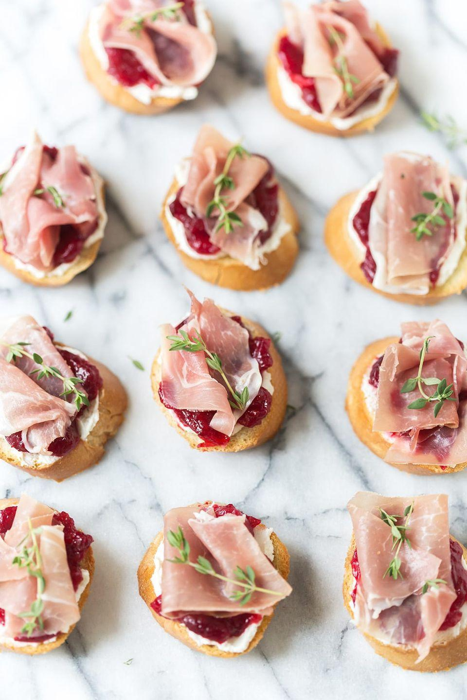 """<p>Make some extra cranberry sauce to use for this hand-held starter. It'll add a hint of tartness to the goat cheese and prosciutto crostini. </p><p><strong>Get the recipe at <a href=""""https://pizzazzerie.com/recipes/cranberry-prosciutto-crostini/"""" rel=""""nofollow noopener"""" target=""""_blank"""" data-ylk=""""slk:Pizzazzerie"""" class=""""link rapid-noclick-resp"""">Pizzazzerie</a>.</strong></p>"""