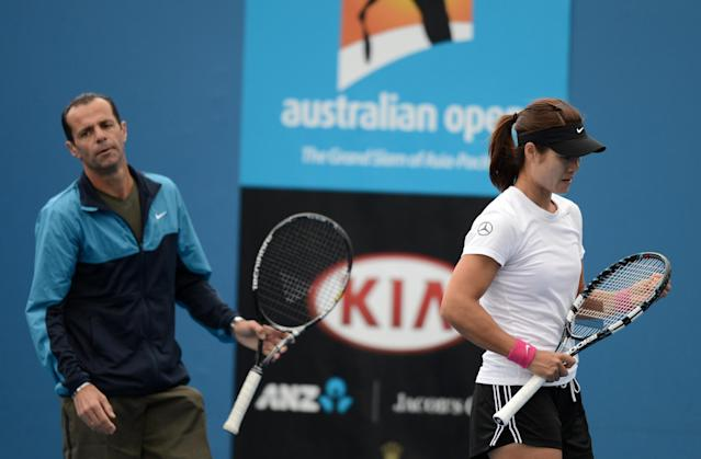 China's Li Na (R) gestures as her coach Carlos Rodriguez looks on during a practice session ahead of the 2013 Australian Open tennis tournament on January 13, 2013. AFP PHOTO/MANAN VATSYAYANA IMAGE STRICTLY RESTRICTED TO EDITORIAL USE - STRICTLY NO COMMERCIAL USEMANAN VATSYAYANA/AFP/Getty Images