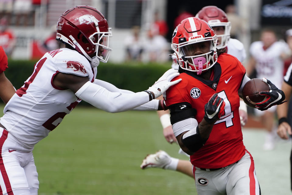Georgia running back James Cook (4). Is pushed out of bounds by Arkansas defensive back Montaric Brown (21) during the first half of an NCAA college football game Saturday, Oct. 2, 2021, in Athens, Ga.. (AP Photo/John Bazemore)