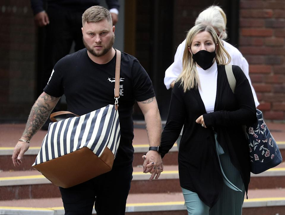 Teacher Kandice Barber, 35, leaves Aylesbury Crown Court, Buckinghamshire, with husband Daniel after being found guilty of two sex offence charges related to sending topless Snapchat pictures to a 15-year-old student.