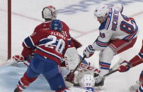 New York Rangers' Pavel Buchnevich (89) scores against Montreal Canadiens goaltender Carey Price as Canadiens' Cale Fleury defends during the second period of an NHL hockey game Saturday, Nov. 23, 2019, in Montreal. (Graham Hughes/The Canadian Press via AP)