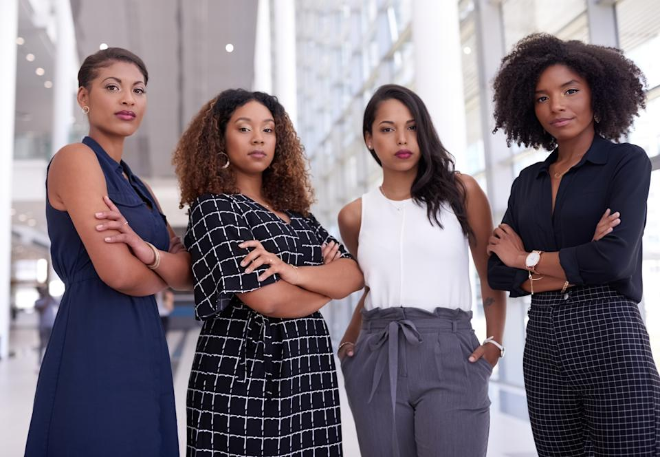 Portrait of a group of young businesswomen working together in a modern office