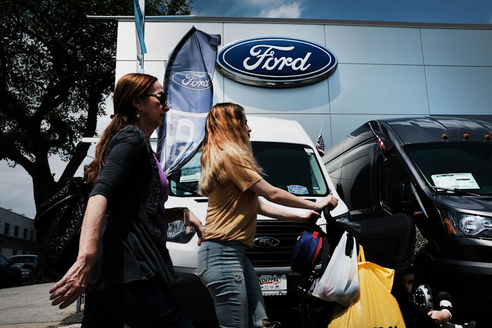 Women walks past cars for sale at a Ford dealership on May 20, 2019 in the Queens borough of New York City. (Photo: Spencer Platt/Getty Images)