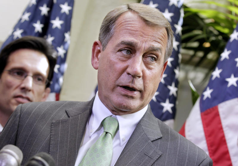 House Speaker John Boehner of Ohio, right, accompanied by Majority Leader Eric Cantor, R-Va., talks to reporters on Capitol Hill in Washington, Wednesday, April 6, 2011, after meeting to work on a budget deal and avoid a government shutdown. (AP Photo/J. Scott Applewhite)