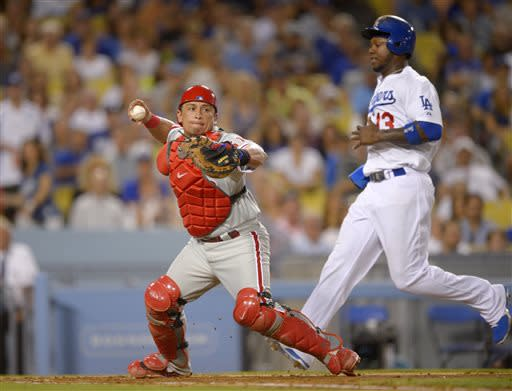 Los Angeles Dodgers' Hanley Ramirez, right, is forced out at home as Philadelphia Phillies catcher Carlos Ruiz, left, throws out Matt Kemp at first during the fourth inning of their baseball game, Saturday, June 29, 2013, in Los Angeles. (AP Photo/Mark J. Terrill)