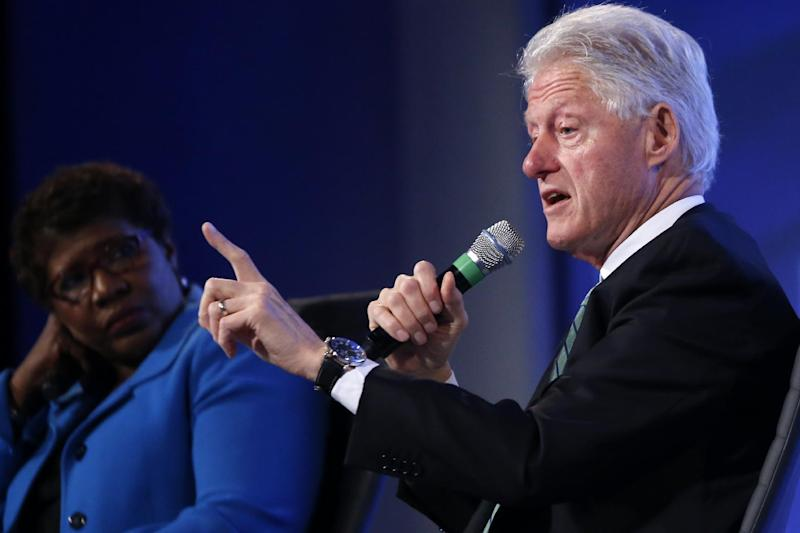 Former President Bill Clinton answers questions from Gwen Ifill of PBS NewsHour at the 2014 Fiscal Summit organized by the Peter G. Peterson Foundation in Washington, Wednesday, May 14, 2014. Lawmakers and policy experts discussed America's long term debt and economic future. (AP Photo)