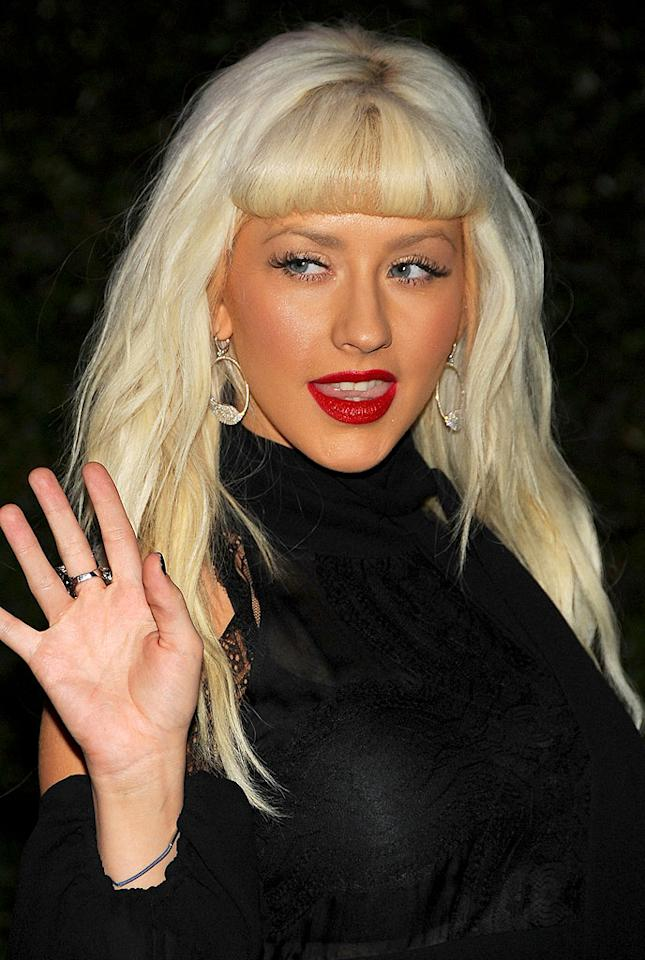 """Even Xtina couldn't pull off a faux glow that thick for a night out. Although, in Christina Aguilera's defense, the tan had to be over the top to compete with her bright red lips and dramatic 'do. Jordan Strauss/<a href=""""http://www.wireimage.com"""" target=""""new"""">WireImage.com</a> - November 10, 2008"""