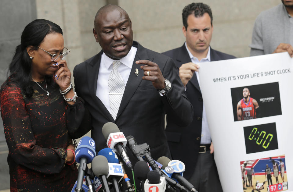 FILE - In this Wednesday, May 30, 2018 file photo, Jewel Upshaw, the mother of G League basketball player Zeke Upshaw, who died in March after collapsing on a court during a game, becomes emotional as attorney Ben Crump speaks at a news conference in front of the U.S. District Court in New York. Jewel Upshaw filed a lawsuit Wednesday accusing the NBA and the Detroit Pistons of negligence. (AP Photo/Seth Wenig)