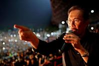 """Malaysian opposition leader Anwar Ibrahim speaks during a rally at a stadium in Kelana Jaya, Selangor on May 8, 2013. Vowing to """"never surrender"""", Anwar called on Malaysians Wednesday to join in a nationwide protest tour against elections he said were stolen from the country's people"""