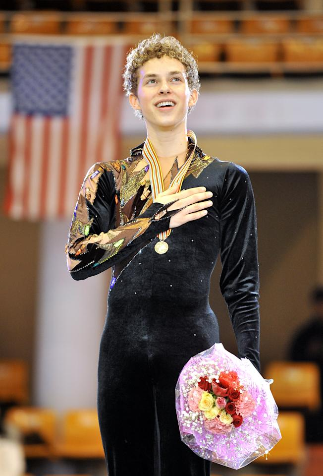 <p>Adam Rippon of the US sings his national anthem during the victory ceremony after the men's free skating event during the ISU Four Continents Figure Skating Championships.<br />(Photo by Jung Yeon-JE/AFP/Getty Images) </p>
