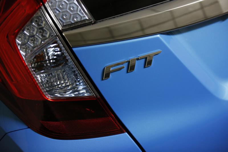 The Fit logo is seen on the body of a Honda Motor's Fit subcompact hybrid car at the company's headquarters in Tokyo