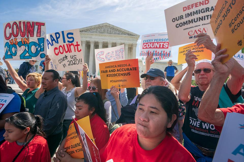 Immigration activists demonstrate outside the Supreme Court in 2019 as the justices hear arguments on the Trump administration's plan to ask about citizenship in the 2020 census.