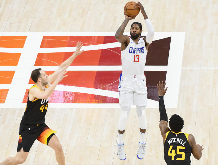 SALT LAKE CITY, UTAH - JUNE 16: Paul George #13 of the Los Angeles Clippers shoots against Donovan Mitchell #45 and Bojan Bogdanovic #44 of the Utah Jazz in Game Five of the Western Conference second-round playoff series at Vivint Smart Home Arena on June 16, 2021 in Salt Lake City, Utah. NOTE TO USER: User expressly acknowledges and agrees that, by downloading and/or using this photograph, user is consenting to the terms and conditions of the Getty Images License Agreement. (Photo by Alex Goodlett/Getty Images)