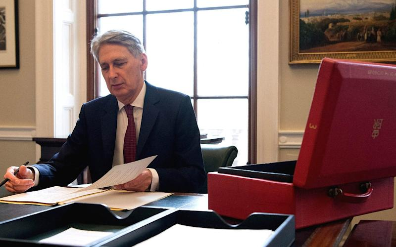 Colleagues claim Philip Hammond did not tell them his Budget plans would break a Conservative manifesto promise - Carl Court /Reuters