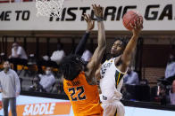 Baylor guard Davion Mitchell, right, shoots as Oklahoma State forward Kalib Boone (22) defends in the first half of an NCAA college basketball game Saturday, Jan. 23, 2021, in Stillwater, Okla. (AP Photo/Sue Ogrocki)