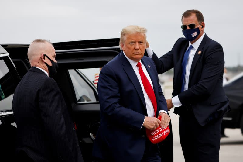 FILE PHOTO: U.S. President Donald Trump arrives to board the Air Force One as he departs for campaign travel at Miami International Airport in Miami, Florida