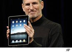 Steve Jobs holds the market-leading iPad