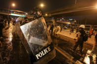 Police react with protesters during a protest in Bangkok, Thailand, Sunday, Feb. 28, 2021. (AP Photo)