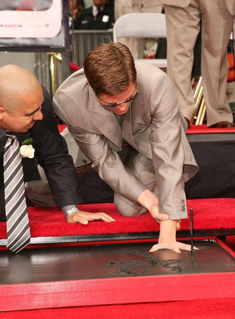 <p>While on a press tour for <em>Ocean's Thirteen</em>, Pitt had a handprint and footprint ceremony at Grauman's Chinese Theater in Hollywood, California.</p>
