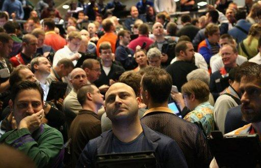 Traders in the Standard & Poor's 500 stock index options pit at the Chicago Board Options Exchange, March 20, 2013