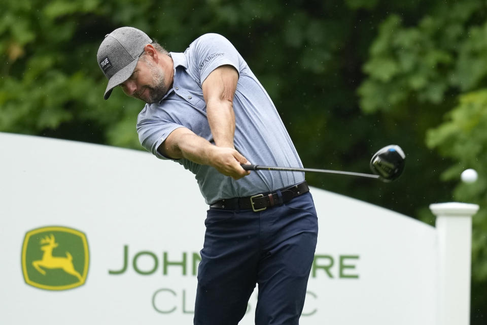 Ryan Moore hits off the 17th tee during the third round of the John Deere Classic golf tournament, Saturday, July 10, 2021, at TPC Deere Run in Silvis, Ill. (AP Photo/Charlie Neibergall)