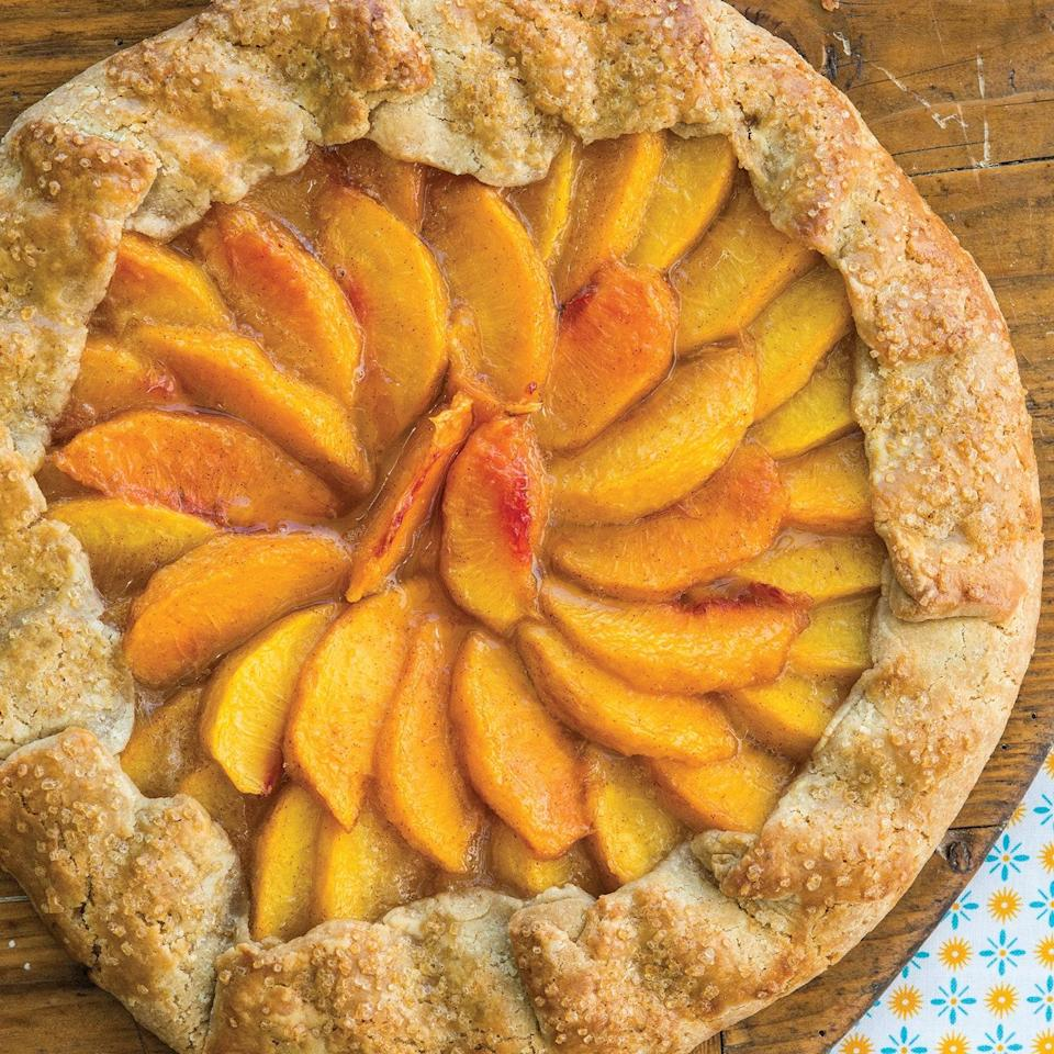 """Peaches are one of summer's prettiest fruits, and galettes look good no matter what—so this homey dessert can't help but turn out a stunner. A little bit of whole wheat flour in the crust gives it warm, nutty undertones. <a href=""""https://www.epicurious.com/recipes/food/views/peach-galette-51185810?mbid=synd_yahoo_rss"""" rel=""""nofollow noopener"""" target=""""_blank"""" data-ylk=""""slk:See recipe."""" class=""""link rapid-noclick-resp"""">See recipe.</a>"""