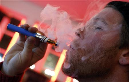 A customer puffs on an e-cigarette at the Henley Vaporium in New York City