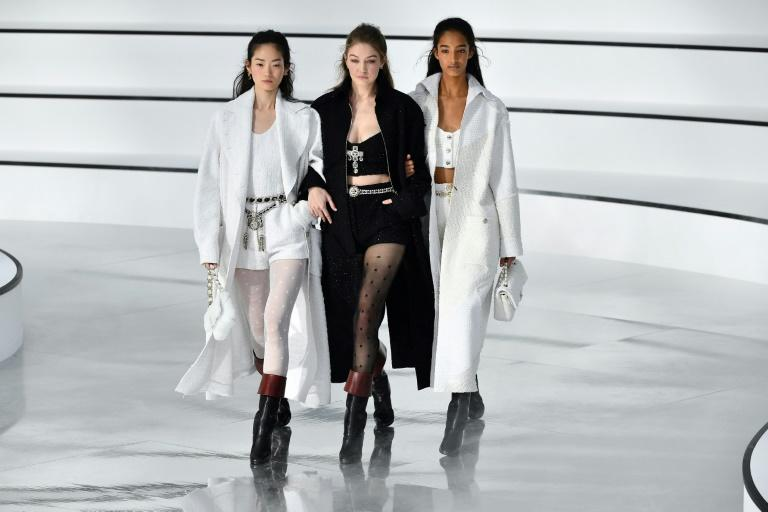 Chanel's no show: Models Hyun Ji Shin, Gigi Hadid and Mona Tougaard close Chanel's understated Paris fashion week show, which was far cry from the spectacular extravaganzas Karl Lagerfeld staged for the brand