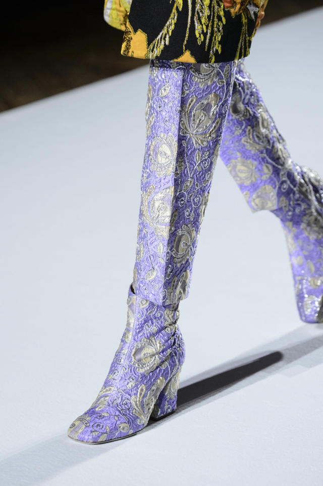 <p><i>Metallic purple embroidered boots from the SS18 Dries Van Noten collection. (Photo: ImaxTree) </i></p>
