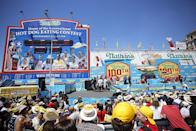 """<p>Nathan's annual July 4th hot dog eating contest reportedly began on July 4, 1916, when, according to its site, <a href=""""https://nathansfamous.com/the-stand/hdec-fun-facts/"""" rel=""""nofollow noopener"""" target=""""_blank"""" data-ylk=""""slk:four recent U.S. immigrants made their own competition"""" class=""""link rapid-noclick-resp"""">four recent U.S. immigrants made their own competition </a>at Nathan's original Coney Island stand. The first recorded contest took place in 1972, and in 2018, <a href=""""https://www.guinnessworldrecords.com/world-records/546576-most-hot-dogs-eaten-at-a-nathans-hot-dog-eating-contest-male"""" rel=""""nofollow noopener"""" target=""""_blank"""" data-ylk=""""slk:Joey Chestnut set a world record"""" class=""""link rapid-noclick-resp"""">Joey Chestnut set a world record</a> by consuming 74 hot dogs in 10 minutes. <br></p>"""