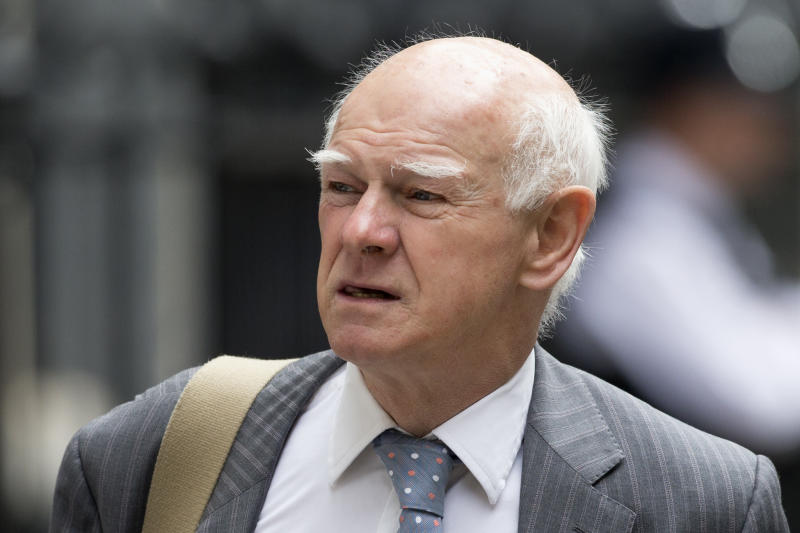 The Royal Bank of Scotland Group Chairman Howard Davies arrives for a meeting of senior financial services leaders with Britain's Chancellor of the Exchequer George Osborne to talk about the next steps for the sector following the British referendum vote to leave the European Union at 11 Downing Street, in London, Tuesday, July 5, 2016. British Prime Minister David Cameron announced his resignation on June 24 after Britain voted to leave the European Union in a referendum. (AP Photo/Matt Dunham)
