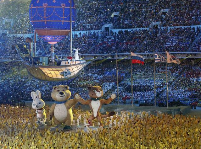 Performers, large mechanized Olympic mascots and a vessel suspended in the air take part in the closing ceremony for the 2014 Sochi Winter Olympics, February 23, 2014. REUTERS/Grigory Dukor (RUSSIA - Tags: SPORT OLYMPICS TPX IMAGES OF THE DAY)