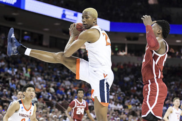 Virginia forward Mamadi Diakite (25) grabs a rebound against Oklahoma forward Kristian Doolittle, right, during the first half of a second-round game in the NCAA men's college basketball tournament Sunday, March 24, 2019, in Columbia, S.C. (AP Photo/Sean Rayford)