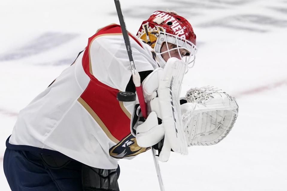 Florida Panthers goaltender Sergei Bobrovsky (72) knocks down a shot from the Dallas Stars using his arm pad during the second period of an NHL hockey game in Dallas, Saturday, April 10, 2021. (AP Photo/Tony Gutierrez)