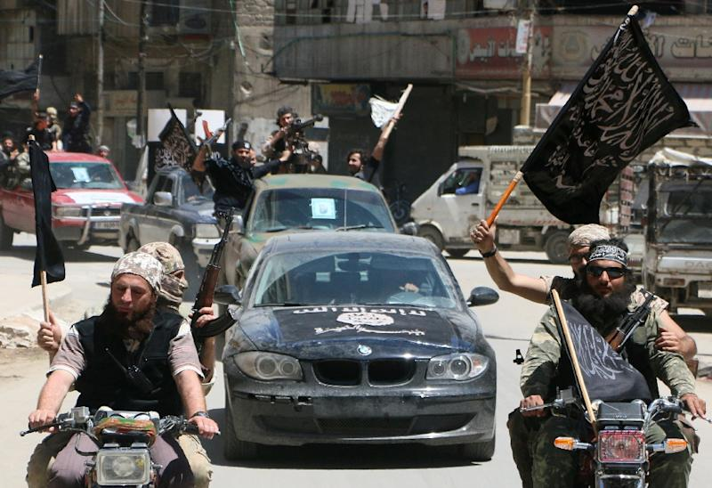 Fighters from Al-Qaeda's Syrian affiliate Al-Nusra Front drive on May 26, 2015