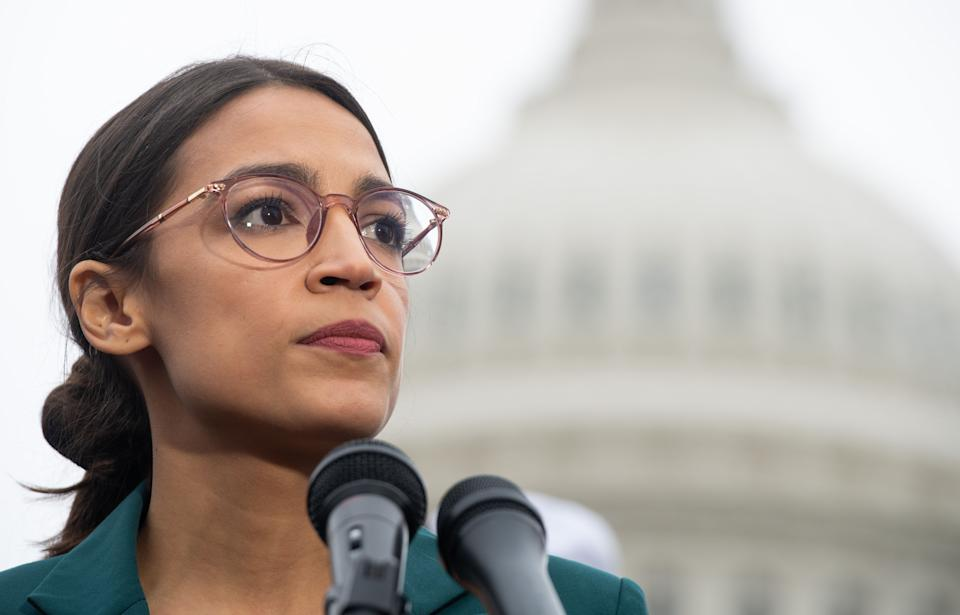 In this file photo taken on 7 February 2019, US representative Alexandria Ocasio-Cortez, Democrat of New York, speaks during a press conference to announce Green New Deal legislation to promote clean energy programs outside the US Capitol in Washington, DC ((AFP via Getty Images))