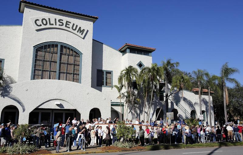 Hundreds of people line up outside of the Coliseum in St. Petersburg, Fla., waiting to hear former President Bill Clinton speak at a campaign event for Barack Obama, Friday Nov. 2. 2012. (AP Photo/Scott Iskowitz)
