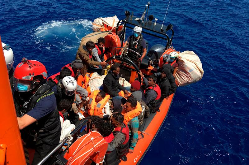 Somme of the 51 migrants, who were drifting on a wood boat, are rescued by members of French NGO SOS Mediterranee boat Ocean Viking, off the coast of Lampedusa island on June 25, 2020. - Dozens of migrants drifting in the Mediterranean on a blue wooden boat were rescued on June 25, 2020 by activists on a ship chartered by a French charity, an AFP reporter on board said. The Ocean Viking -- chartered by French aid group SOS-Mediterranee -- rescued 51 people in total, including one woman and five children, mainly of Pakistani and Eritrean nationality. (Photo by Shahzad ABDUL / AFP) (Photo by SHAHZAD ABDUL/AFP via Getty Images) (Photo: SHAHZAD ABDUL via Getty Images)