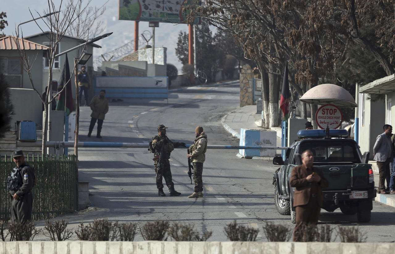 <p>Security forces stand guard at a gate of Intercontinental Hotel after the deadly attack, in Kabul, Afghanistan, Jan. 21, 2018. (Photo: Massoud Hossaini/AP) </p>
