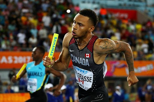 Andre De Grasse's runs a startling third leg in the 4x200m relay to give Canada gold, the first time a country other than the US or Jamaica had won a sprint relay (AFP Photo/Matthew Lewis)